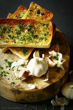 The secret to making the most flavourful and garlicky garlic bread is to start with a cold sauce pan and into it add softened butter along with finely minced garlic. Melt and saute the mixture over medium heat until the heady scent of garlic permeates the air and it gets soft but not browned.