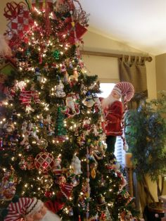 Elf Decorating the Christmas Tree, Christmas Tree with Elves decorating the tree..lots of Christopher Radko ornaments on the tree. , Christm...