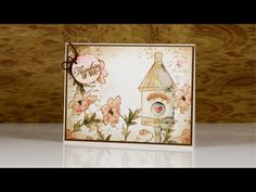 A tutorial showing how I create a vintage style watercolour card using Penny Black stamps, distress ink, watercolour pencils and the elegant writer pen.