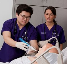 Students administering a nebulizer treatment to SimMan 3G at NYU College of Nursing