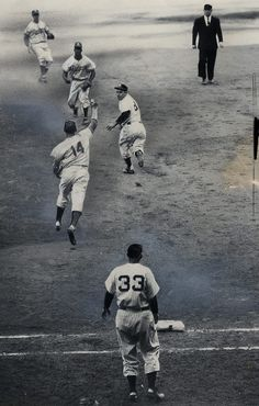 Yogi Berra caught in a rundown during the 1953 World Series. New York. October 2, 1953. [635x997]