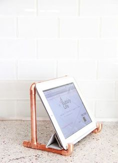 Copper tablet resting spot: http://www.stylemepretty.com/living/2015/02/20/25-ways-to-add-copper/