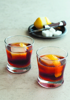 Cosa Nostra: 1½ oz.bourbon 1 barspoon Campari 1 barspoon Rabarbaro Zucca ¼ oz.simple syrup (1:1) 2 dashes Fernet-Branca Tools: mixing glass, bar spoon, strainer Glass:Old Fashioned Garnish: lemon twist  In a mixing glass filled with ice, combine all ingredients and stir until chilled.Straininto an Old-Fashioned glass filled with one large ice cube. Twist a strip of lemon peel over the glass and drop it in to garnish.