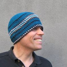 this beanie was hand crocheted with deep blue wool and accented by stripes of light blue, navy and brown cotton...it is 8 long and will fit ( or