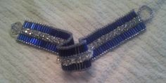 peyote stitch bracelet using bugle beads, seed beads and then swarovski crystals stitched on over the top