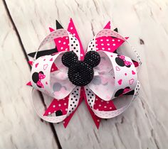 A personal favorite from my Etsy shop https://www.etsy.com/listing/541079010/minnie-mouse-hairbow-red-black-white