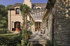 Hunting Valley, Ohio - narrow but lovely wood pergola to accent the stone house.