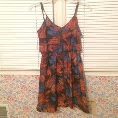 Multicolored feathered dress Only worn once! In perfect condition and has a zipper that goes down the middle Xhilaration Dresses