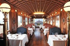 In the dining car, extensive rich wood detailing, from the chevron parquet pearwood floors to the coffered, arched ceiling, competes with epic views of Japan's countryside.