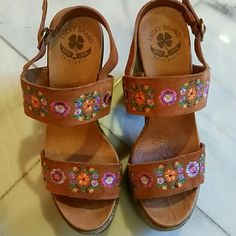 Lucky Brand Embroidered Leather Wedge Gorgeous floral embroidery highlight these leather and suede lightweight cork wedge sandals. Very good condition. 11/2 inch platform with a 4 1/2 inch heel. Goes PERFECT with my J. Crew Leather Belt Lucky Brand Shoes Platforms