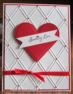 handmade Valentine card from Our Little Inspiration ... white and red ... backgrond of double line diamond texture ... luv the little red gems n the diamonds formed at the crossing ... one deep red die cut heart ... luv it!