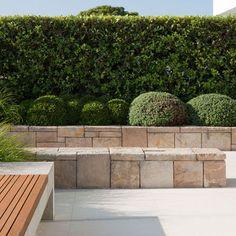 Mosman Landscape by Secret Gardens of Sydney via Houzz Sandstone sitting wall, raised garden bed, garden bench seat