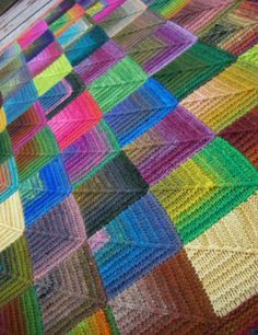 Mitred square Knitted Blanket. The instructions are at this link: http://www.shellykang.com/all-about-the-blankie