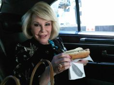 Joan Rivers with a hot Dog
