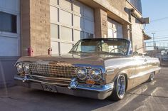 1963 chevrolet impala convertible front profile in front of las vegas fire station