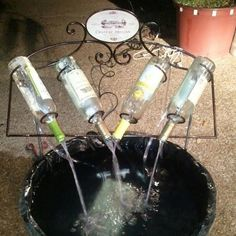 wine bottle fountain we made Wine Bottle Fountain, Wine Bottle Glasses, Wine Bottle Corks, Wine Cork Crafts, Wine Bottle Crafts, Small Water Features, Glow Jars, Bottle Trees, Backyard Water Feature