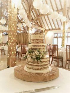 A stunning semi naked wedding cake