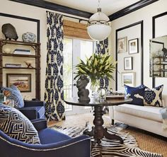 Love the layered, textured, exotic vibe in this room by Barclay Butera. Off white walls and black millwork and moulding play perfectly with navy patterned draperies and pillows, tons of grasscloth and - Modern Living Room Blue And White Curtains, Blue And White Living Room, White Walls, West Indies Decor, Living Room Decor, Living Spaces, Blue Living Room Chairs, Curtains In Living Room, Blue Living Rooms
