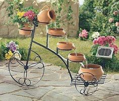 A terracotta tricycle flowerpot.