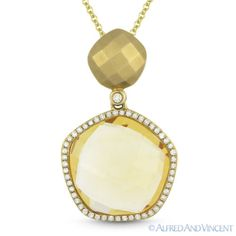 The featured pendant is cast in 14k yellow gold and showcases a faceted piece dangling a fancy halo design set with a yellow citrine center gem & round cut diamond accents.