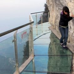 Glass Walkway Built On The Side Of A Mountain.