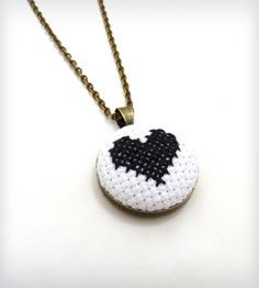 Black and White Cross Stitched Heart Necklace.  Except with a silver chain