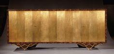 Eugène  Printz (1889-1948): Enfilade rectangulaire  plaquée de bois de palmier avec quatre portes en métal (laiton oxydé patiné), à décors géométriques réalisées par Jean Dunand. 1928.