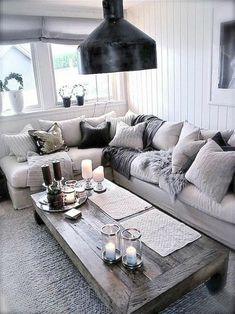 Totally swooning over this cozy chic living room! The different shades of grey a. Totally swooning over this cozy chic living room! The different shades of grey against a light couch brings a modern twist to your home decor. Cozy Living Rooms, My Living Room, Apartment Living, Home And Living, Living Spaces, Cottage Living, Living Area, Cozy Apartment, Apartment Ideas