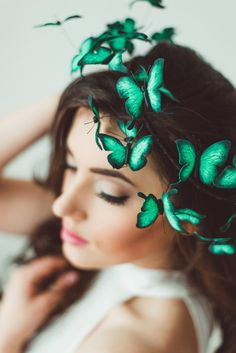 Eten Iren's fairy tale hair accessories feature kaleidoscopes of butterflies that look like they've gathered around your head.