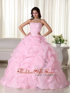 Pink Ball Gown Strapless Floor-length Organza Beading Quinceanera Dress- www.fashionos.com www.facebook.com/...  Strapless dresses are one of the sexier styles on the market today. They show just enough skin to be classy without being too revealing. This fantastic dress features a sweetheart neckline and sparse but not monotonous beading on the top part of the dress. The organza on the outlayer of the skirt make the dress look puffy.