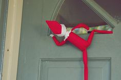 """Front Door looking in the window. Maybe this is how the kiddos first meet Elf...."""