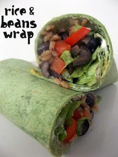 Healthy Rice and Bean Wrap. I would use lots of tomatoes and maybe some yummy salsa (corn salsa?) and cilantro.