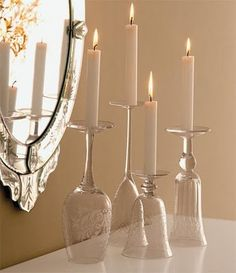 upside down wine glasses as taper candle holders