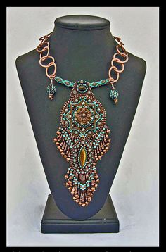 Beaded necklace.  Like the attachment of chain to stiff cross-member and the dangles