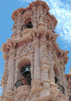 The baroque bell tower of Santa Prisca Church in Taxco, Mexico in the Churriesgo style = Baroque on steroids - Photograph by Phil Carter.