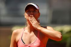 Maria Sharapova Photos - Maria Sharapova of Russia blows a kiss to the crowd after her three set victory against Caroline Wozniacki of Denmark in their quarter final round match during day six of the Mutua Madrid Open tennis tournament at the Caja Magica  on May 7, 2015 in Madrid, Spain. - Mutua Madrid Open - Day Six