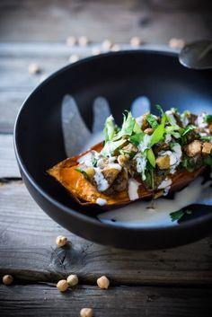 "Healthy Moroccan Stuffed Sweet Potatoes w/ Ras El Hanout, chickpeas, apples, onion, garlic & cilantro - Keep this vegan, or drizzle with delicious ""smoked"" yogurt. | www.feastingathome.com #sweetpotato #yam"