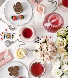 Alice in Wonderland Tea Party... I replicated this theme for an anniversary dinner and loved it.