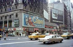 New York City: Times Square with the smoking Camel sign, 1960s.