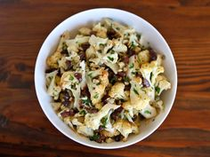 Roasted cauliflower salad from Calabria, Italy with olives, capers, chili peppers, parsley and olive oil. Healthy, gluten free, vegan, pareve