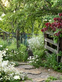PrivateMosaicGarden: A limestone path, lined with wild daisies, is the centerpiec..