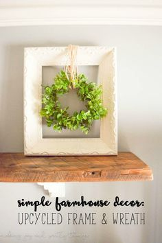 Simple Farmhouse Decor: Upcycled frame wreath! Easy fixer upper and farmhouse style DIY that is budget friendly using an old frame. Add a fresh green wreath and it's a perfect farmhouse-inspired DIY