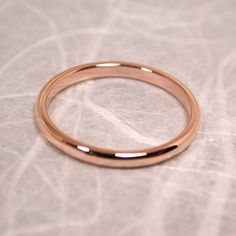 14k Rose Gold Band Modern Romantic Pink Gold Ring Wedding Band by SARANTOS. $240.00, via Etsy.