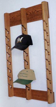 Perfect Gifts Baseball Cap Rack Handcrafted to your specifications - This handcrafted solid oak cap rack holds 24 baseball hats. A wooden hat hanger is a practical gift for any hat collector! Baseball Cap Rack, Baseball Hat Display, Cowboy Hat Rack, Diy Hat Rack, Wall Hat Racks, Hat Shelf, Hat Holder, Hat Storage, Storage Ideas