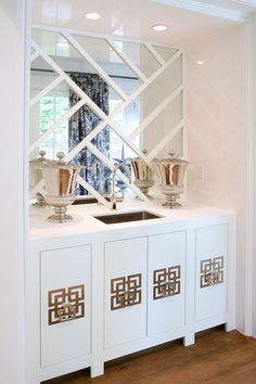 Amazing living room wet bar nook is filled with white lacquer cabinets accented with geometric ...