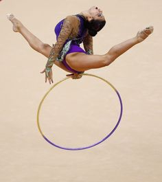 Julie Zetlin of the U.S. competes using the hoop in her individual all-around gymnastics qualification match at the Wembley Arena during the London 2012 Olympic Games August 9, 2012.