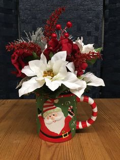 Arrangement Made In A Ceramic Christmas Mug Measures Approximately 12 Inches Tall And 8 Inches