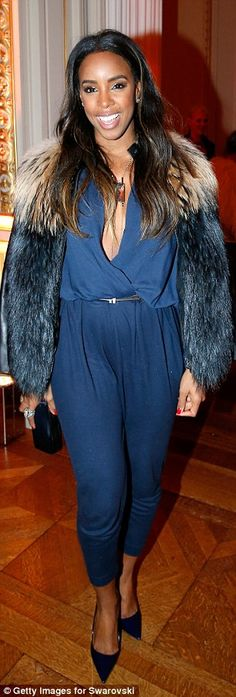 Making a statement: The singer wore a midnight blue jumpsuit with a plunging neckline and ...