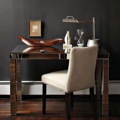 Mirrored Parsons Desk by West Elm.  A little sophisticated glam for my little lady.
