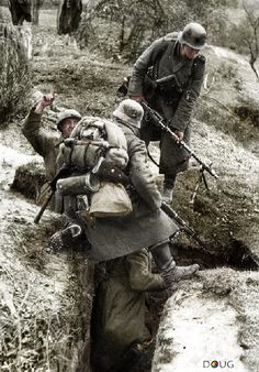 German soldiers examine a Russian trench during the advance towards Moscow…
